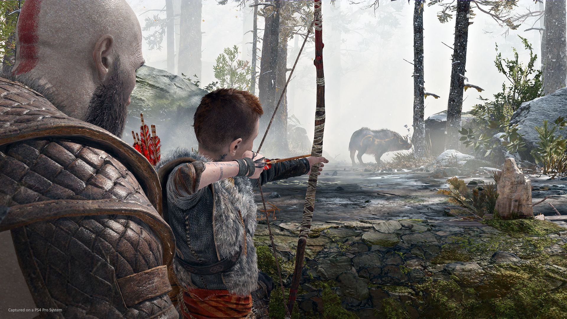 Kratos apprend à Ateus à tirer à l'arc